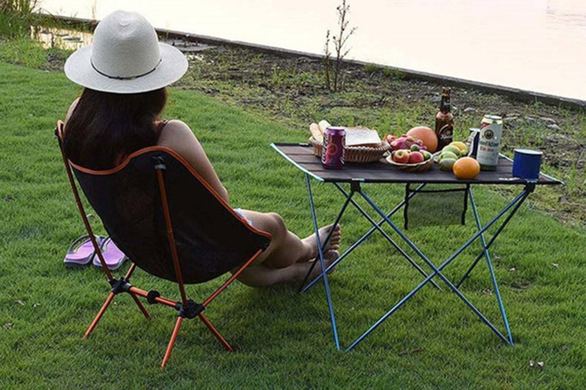 Woman reclining on camping chair
