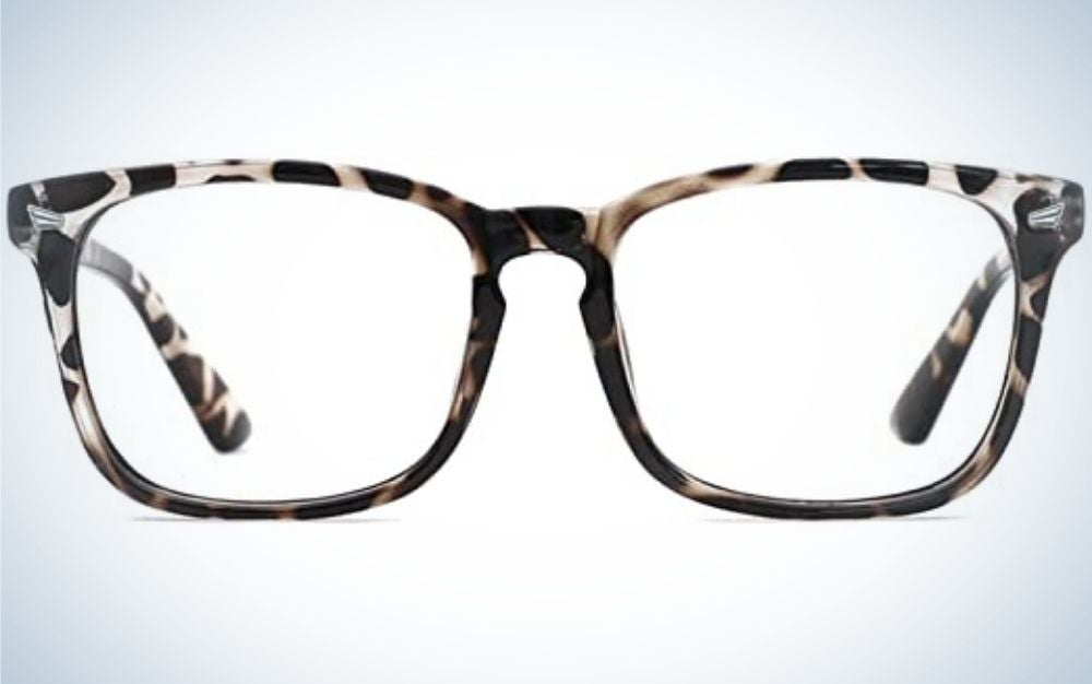 A pair of glasses from the front which have a black and white and brown skeleton and an rectangular shape with a few tips on the tails, as well as transparent glass.