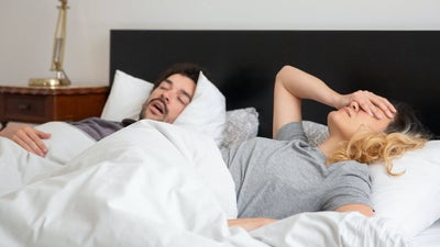 How to share a bed with a restless sleeper