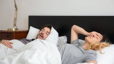 Frustrated couple in bed