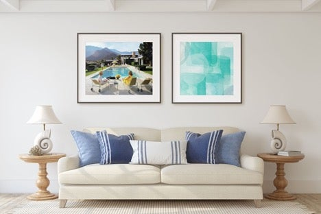 two-framed-photos-over-couch