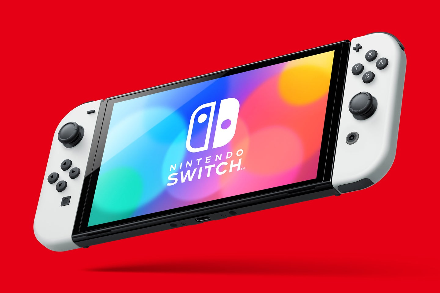 Nintendo Switch OLED console on red background