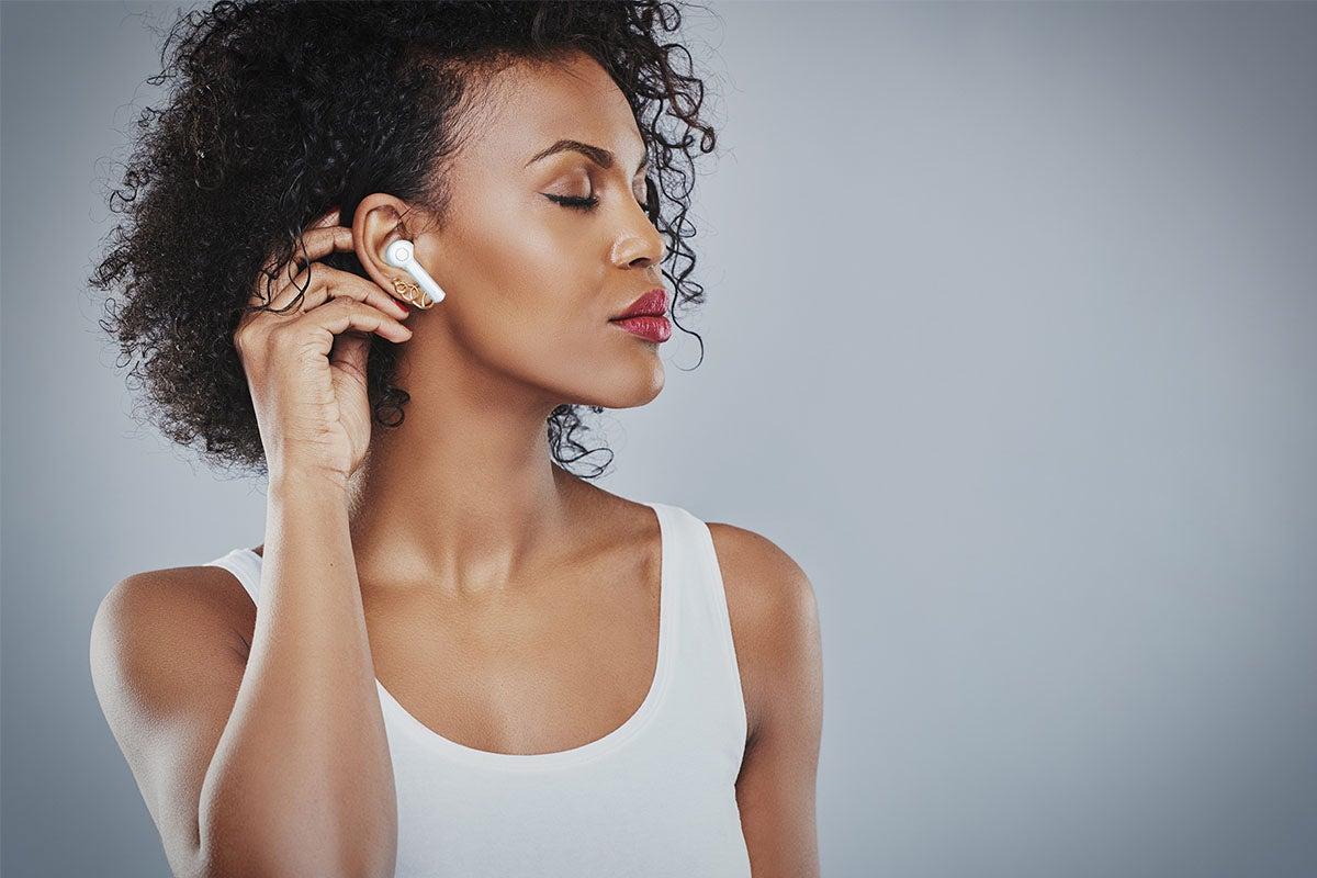 Woman wearing wireless headphones