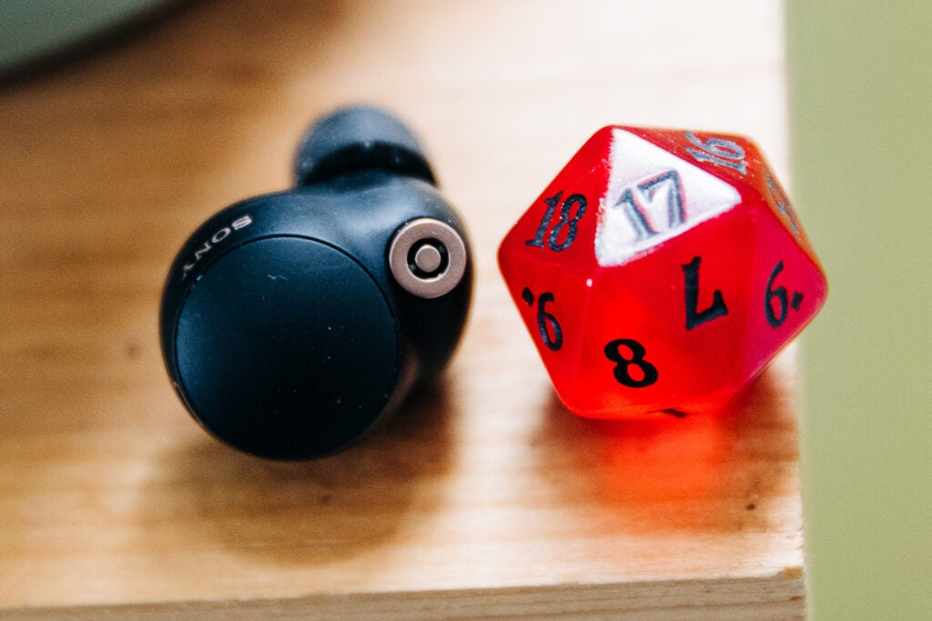 Sony wf-1000xm4 noise canceling earbuds compared to a D20 die