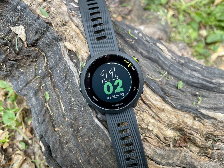 Garmin Forerunner 55 smartwatch on a log
