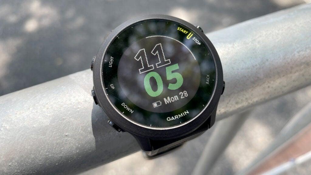 Garmin Forerunner 55 smartwatch on a pole