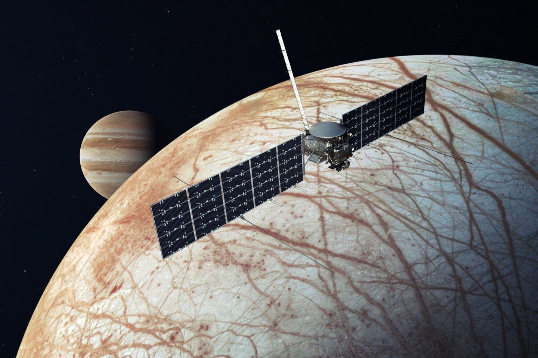 An artist's interpretation of the Europa Clipper spacecraft as it orbits Jupiter's frozen moon Europa.