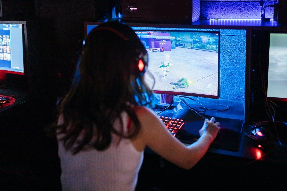 Girl playing games on computer