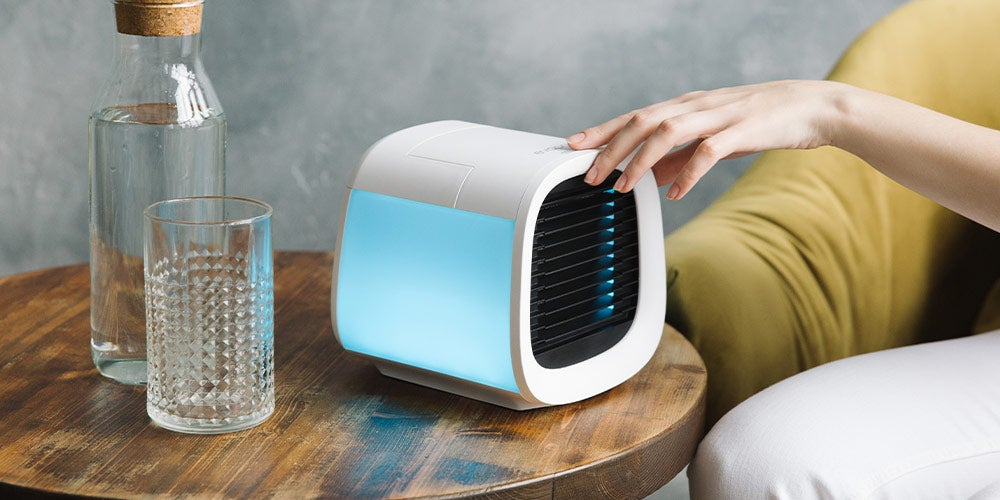 Woman pressing button on air purifier