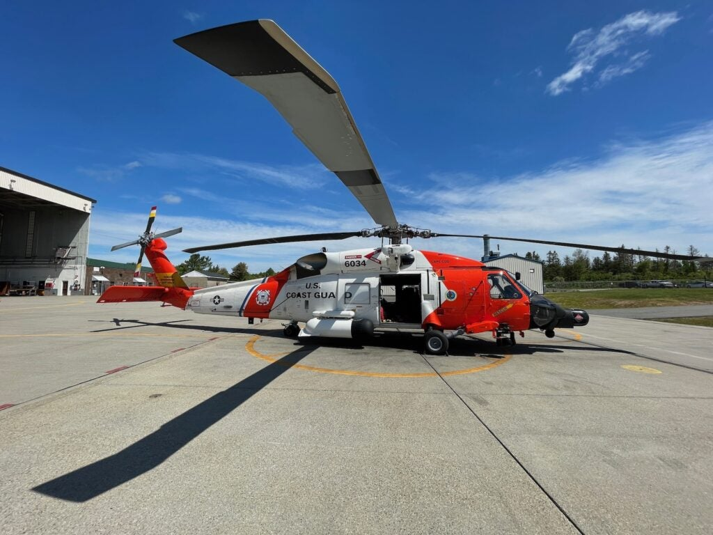 A Coast guard helicopter on the ground