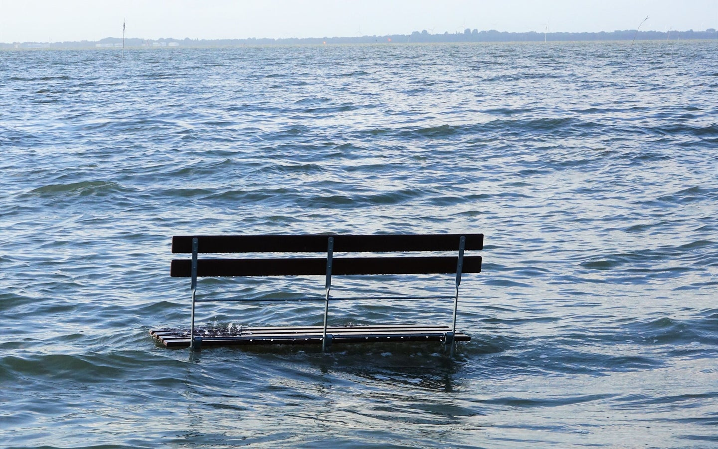 flood waters surrounding a bench