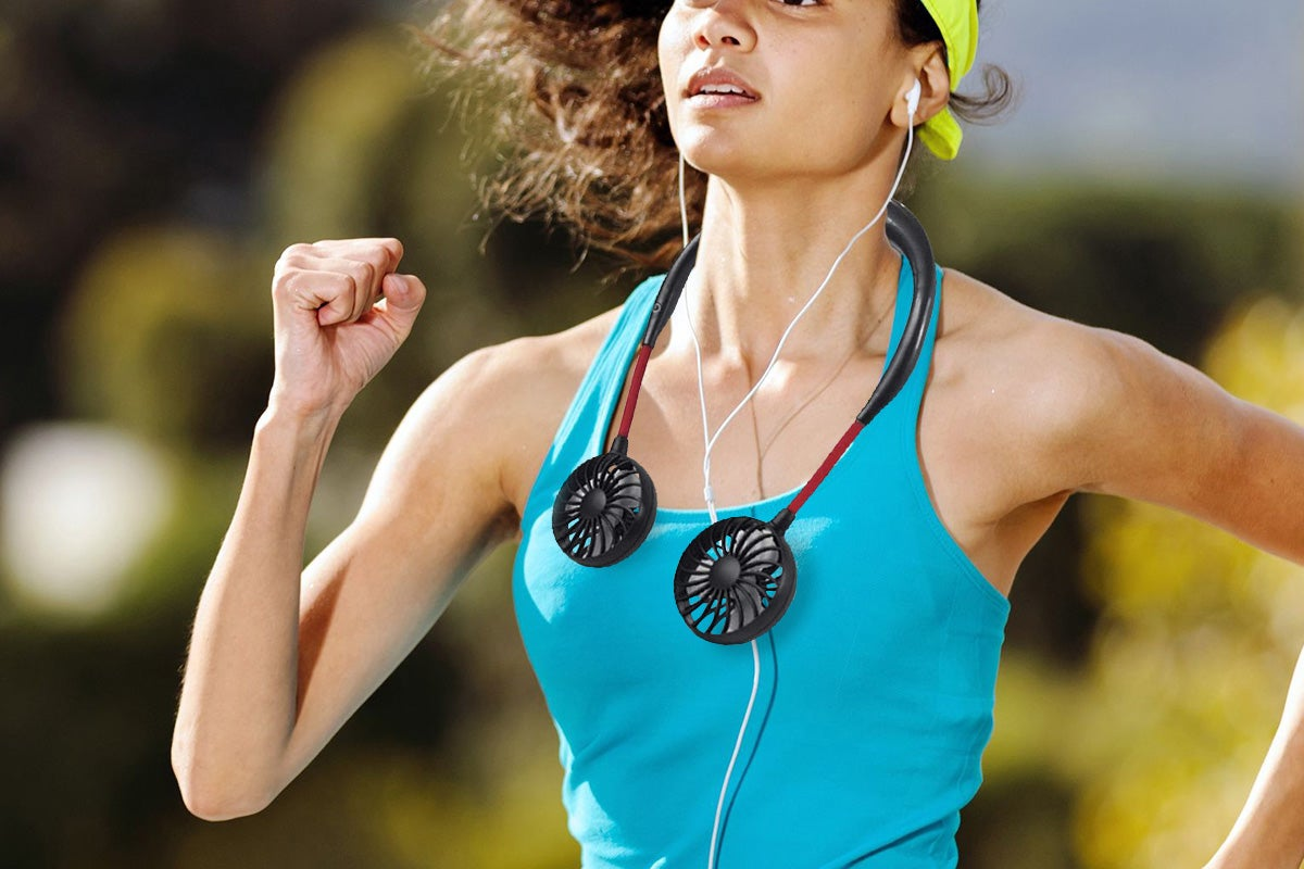 Woman running with portable fan