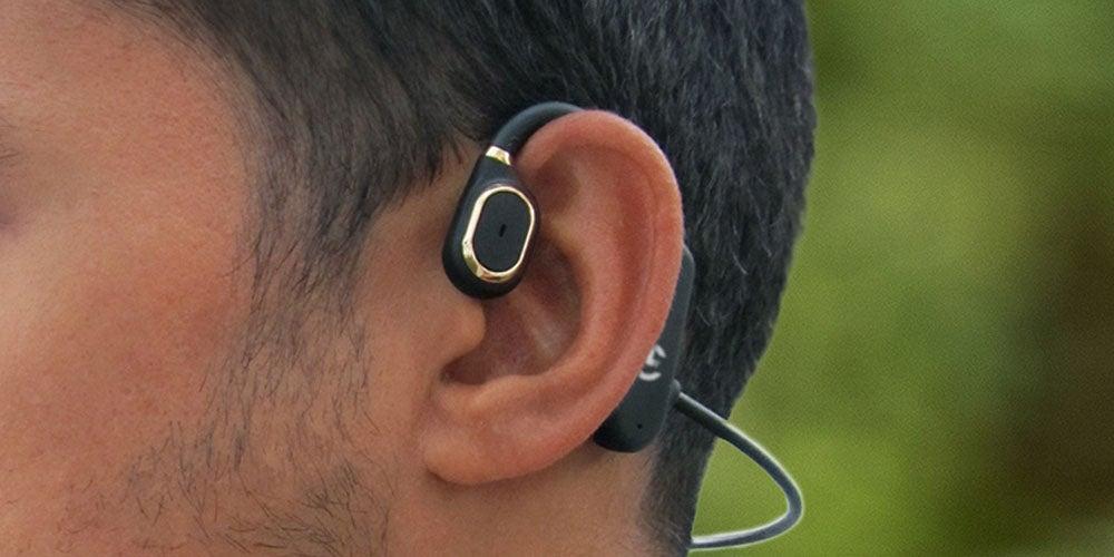 Closeup of man's ear with headphone