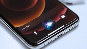 Close up on an iPhone with a Siri activated screen