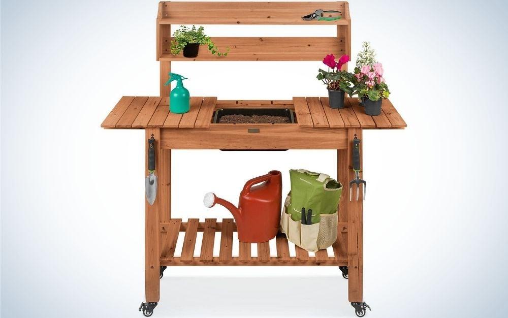 Mobile garden potting bench with garden equipment