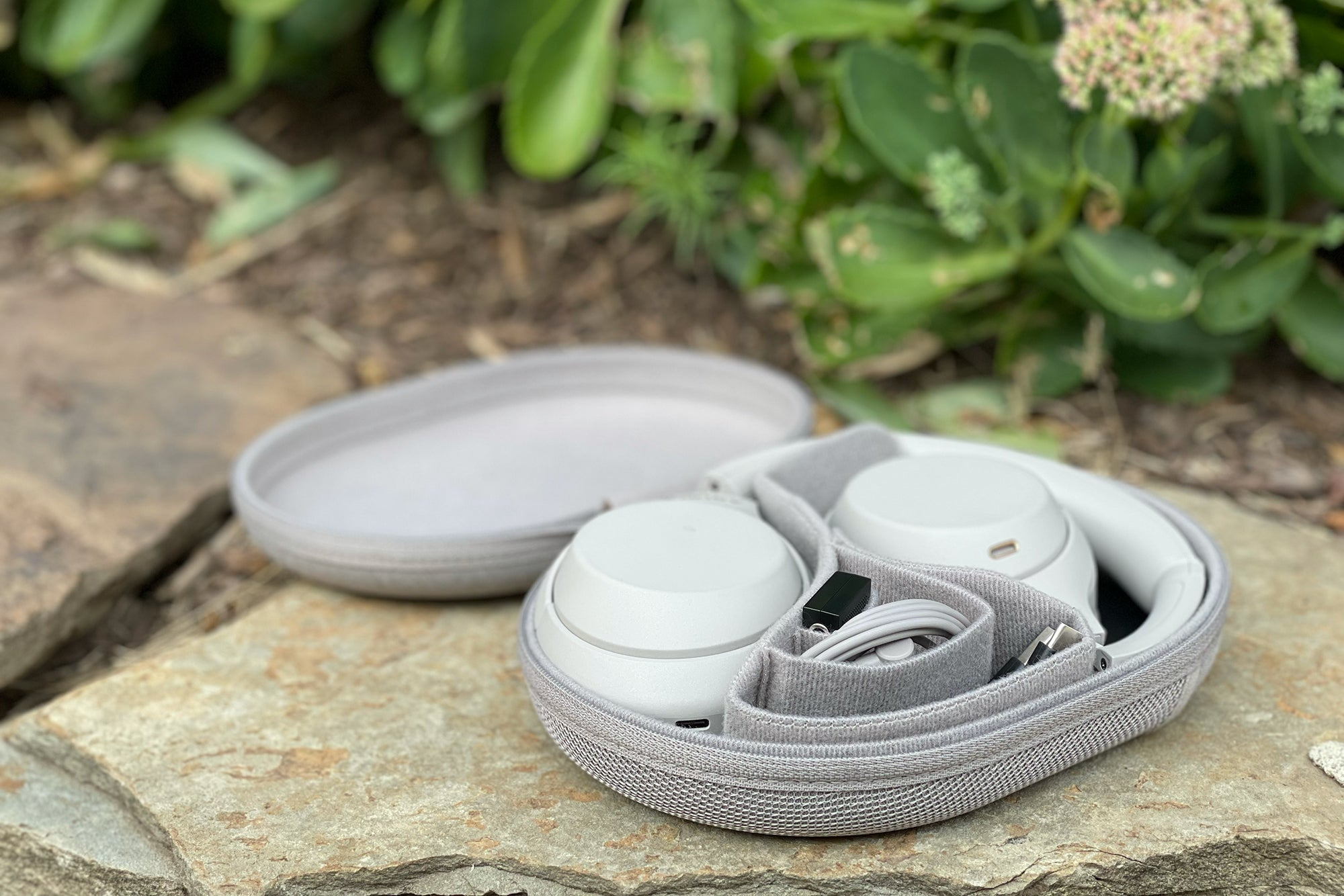 Sony WH-1000XM4 noise cancelling headphones flat in its case