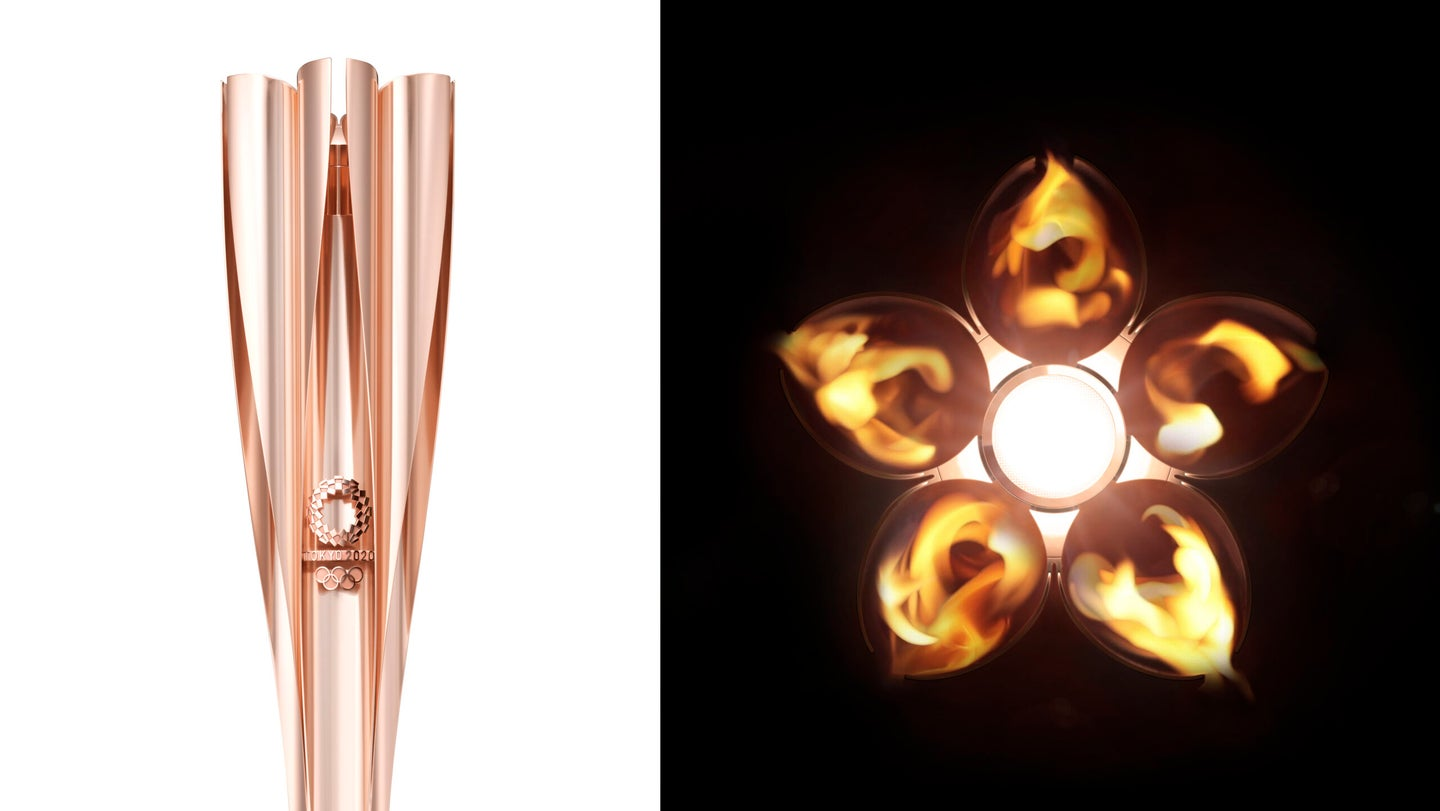 On the left, a side view of the Tokyo 2020 Olympic torch shows the official logo and the rose-gold color of the flower-shaped torch. On the right, a top view of the torch while lit displays the five petals and central flame of the cherry blossom.