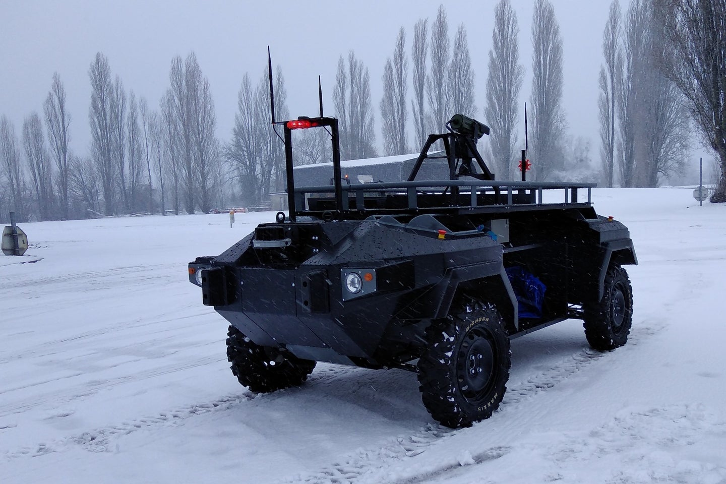 a robotic military vehicle in the snow