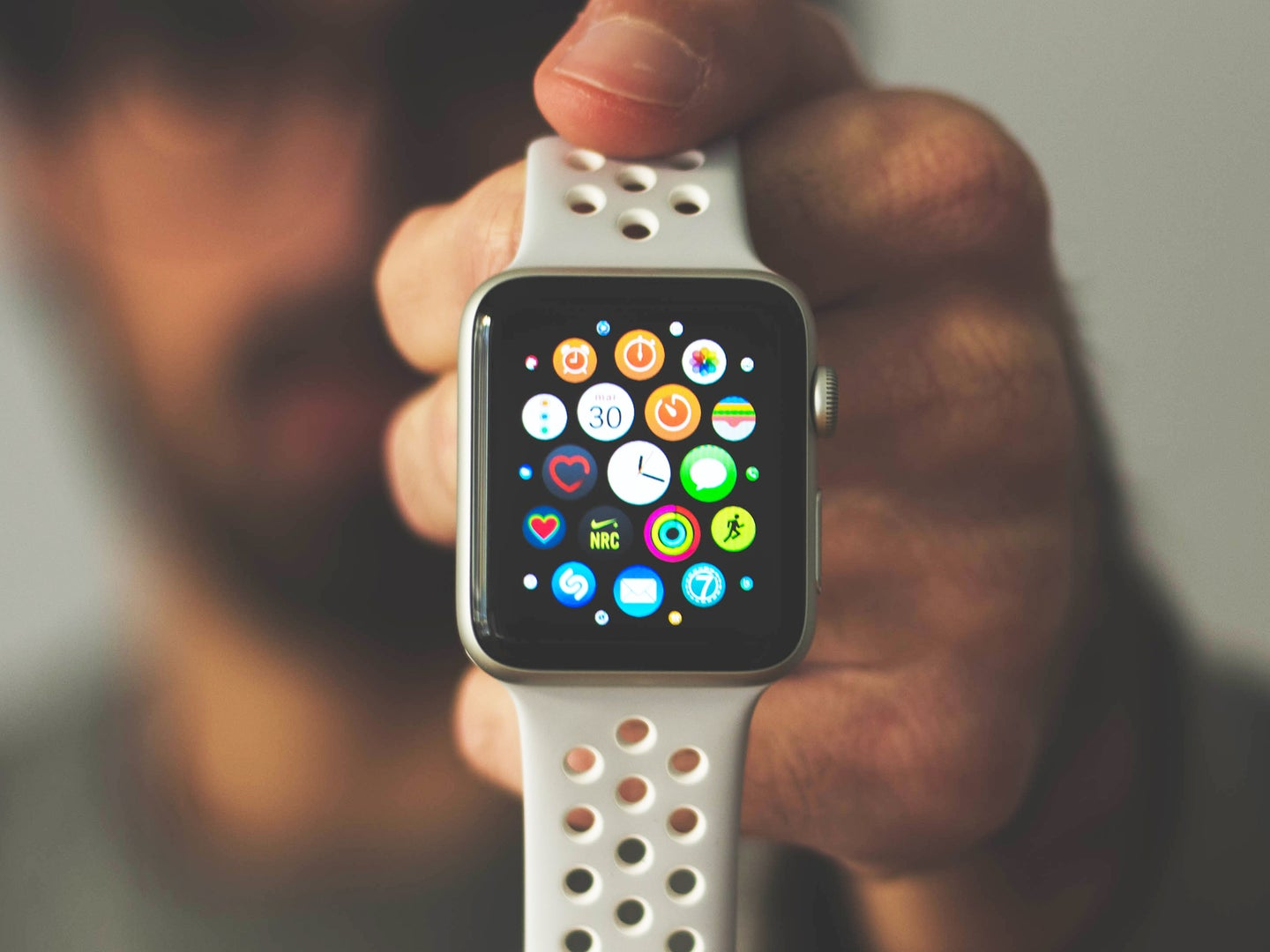 Person holding an Apple Watch to the camera