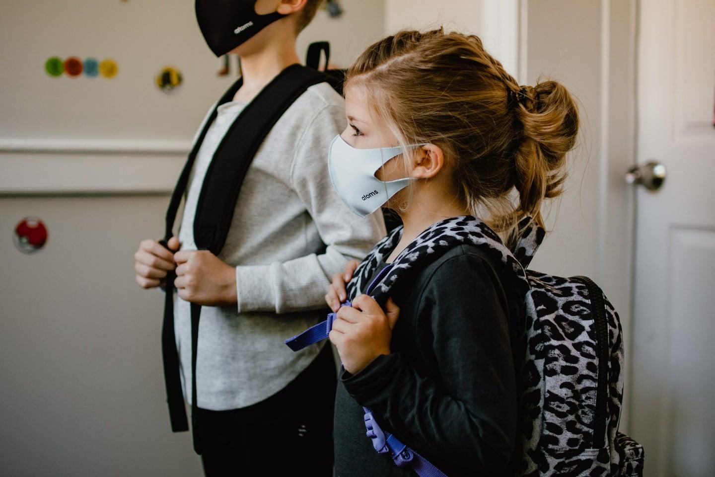 young girl wearing mask