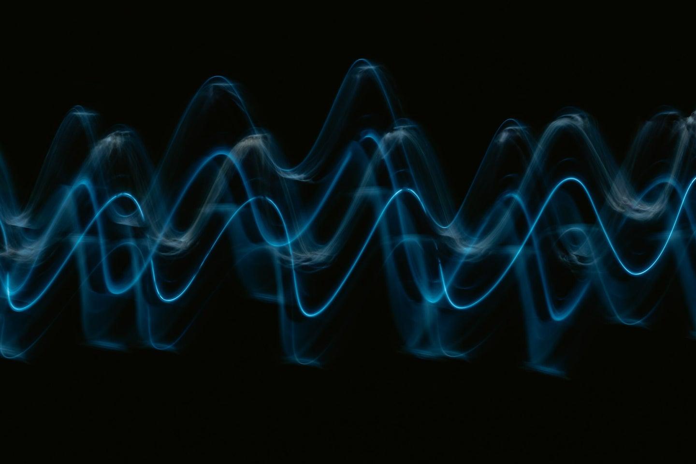 blue sine waves on a black background