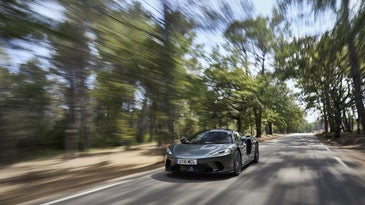 A Mclaren GT supercar driving on the road