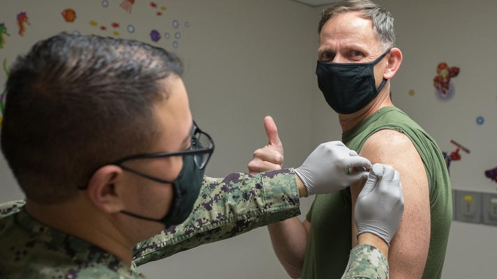 Military service member getting a COVID-19 vaccine shot