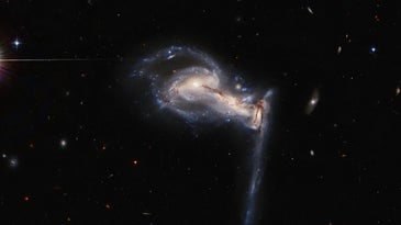 A trio of galaxies swirl around each other.