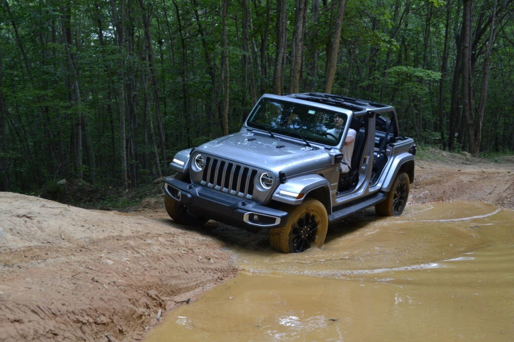 A Jeep Wrangler in the woods