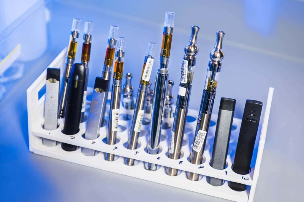 Vaping pens in a lab in a rack