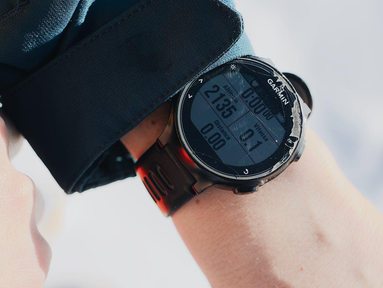 A person wearing a Garmin smartwatch.
