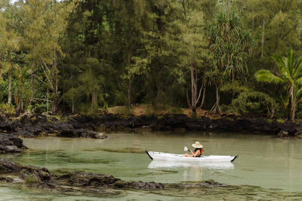a kayak on the water with a person in it