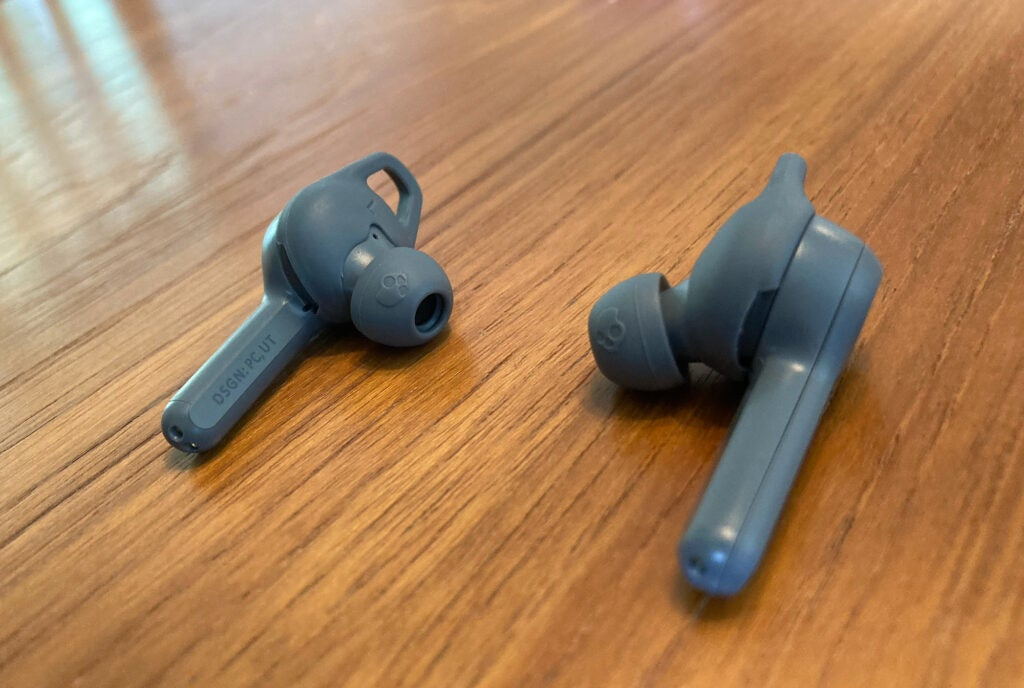 Skullcandy Indy ANC earbuds on wood table