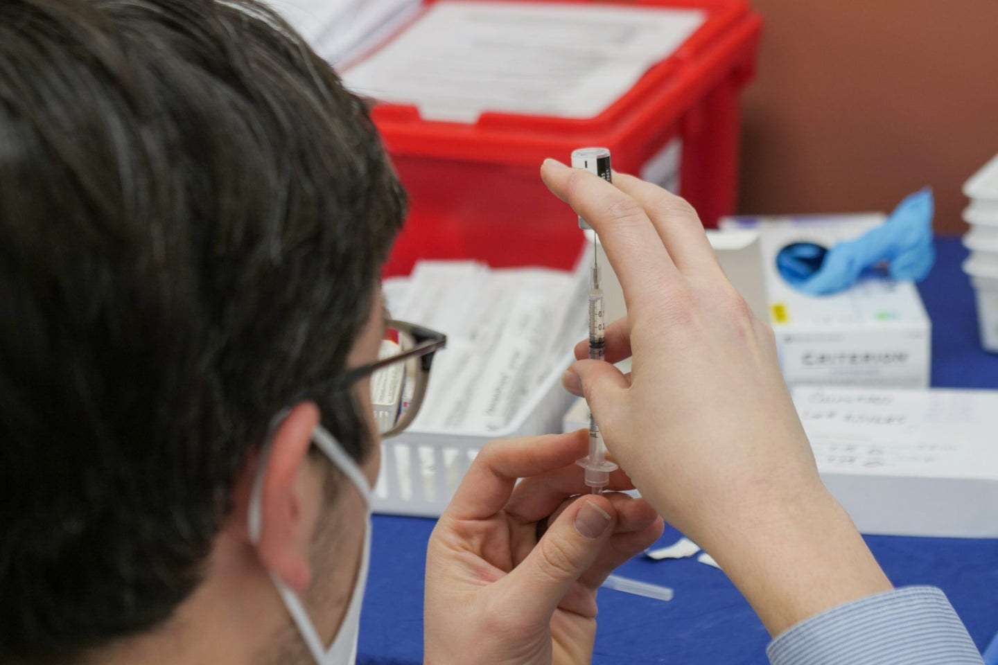person preparing mRNA vaccine to be injected