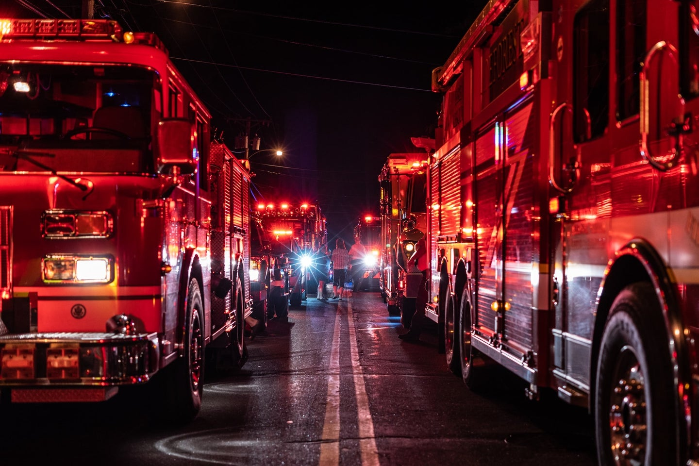 fire trucks lines up on a road