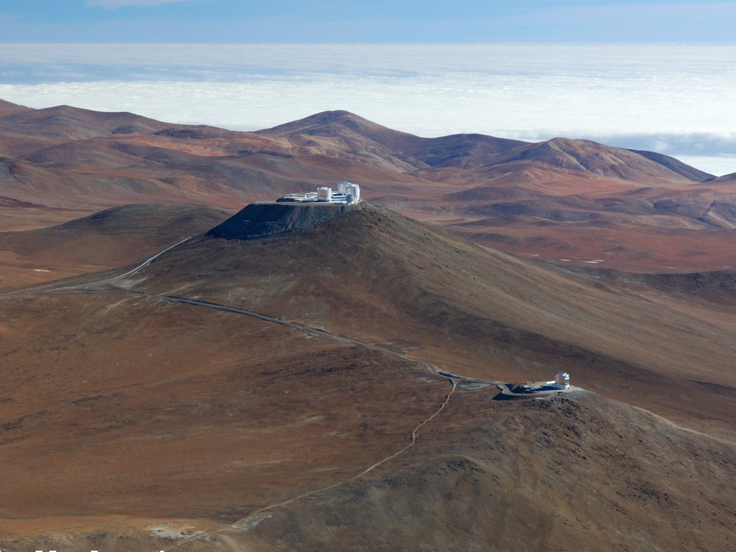 Aerial view of Paranal with VISTA in the foreground and the Very Large Telescope in the background.