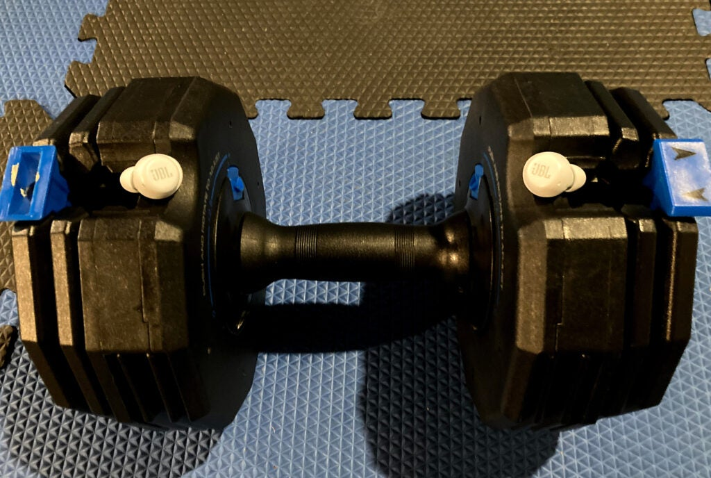 JBL Live Free NC+ TWS on a dumbbell