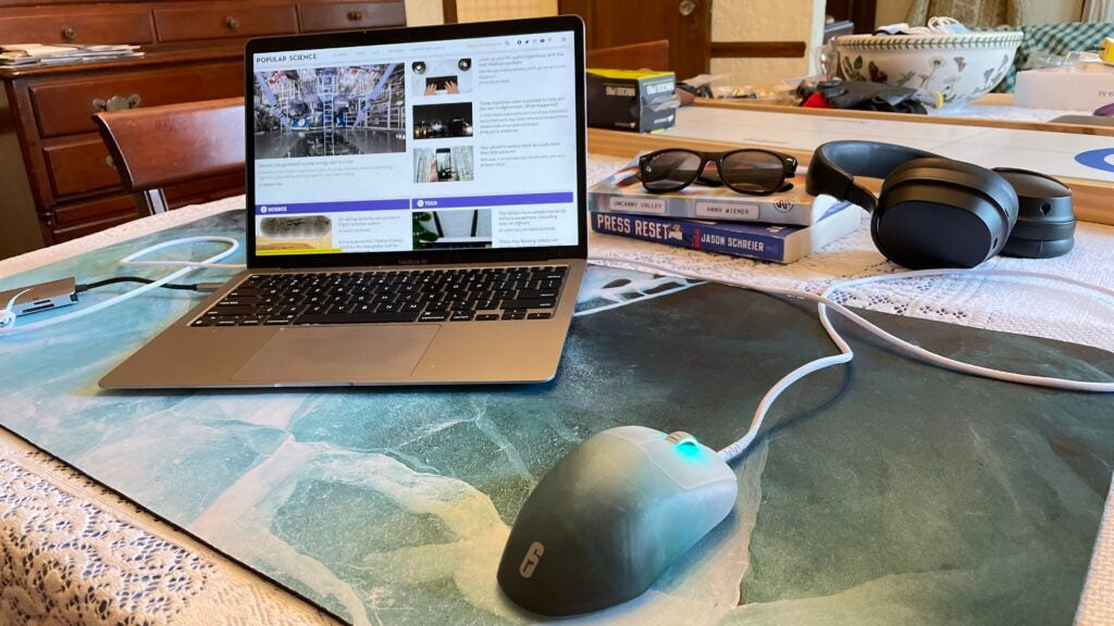 XXL mouse pad with silver laptop and wired mouse on top