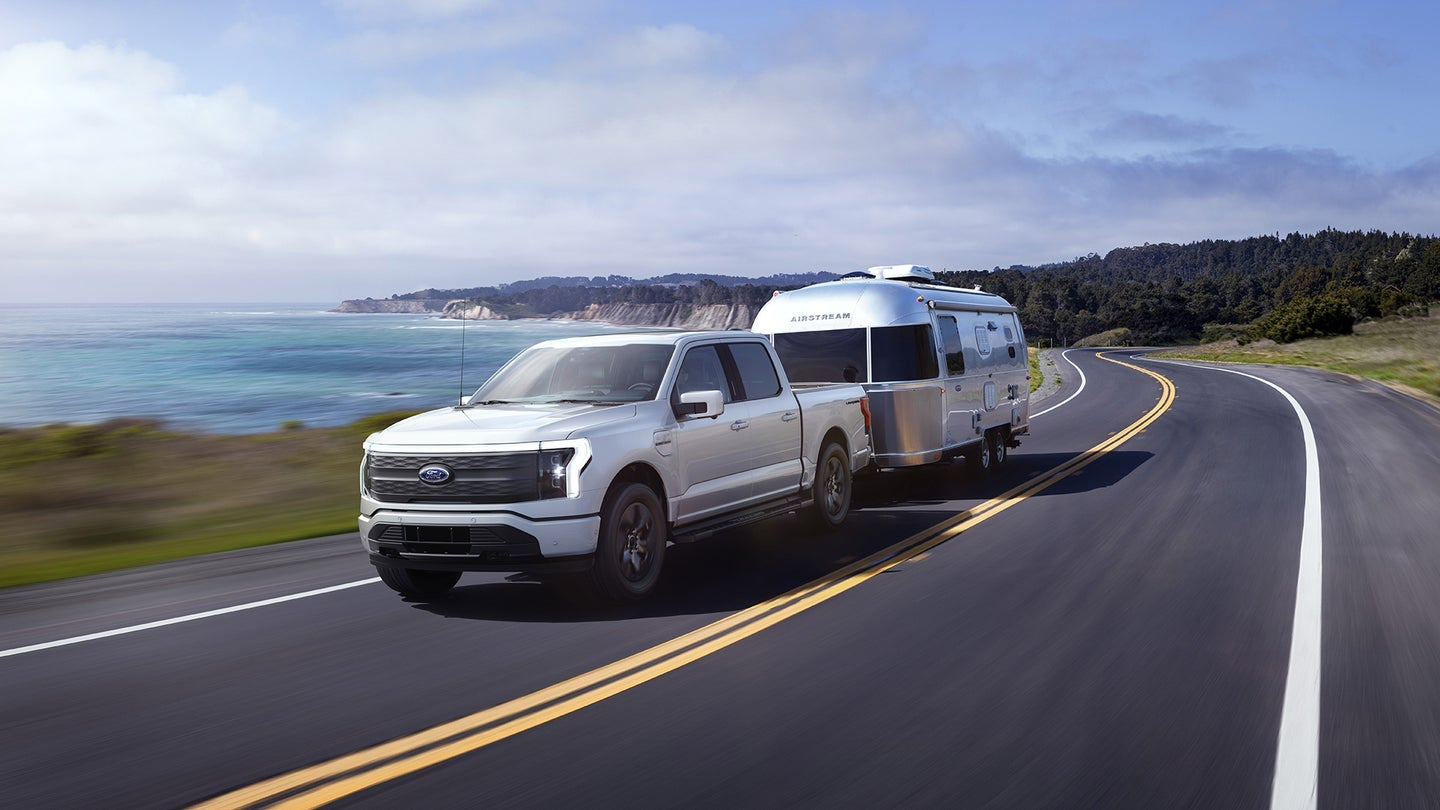 White Ford electric F-150 truck with towing capacity