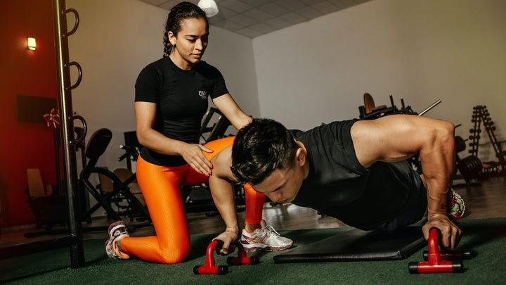 woman helping man build muscle
