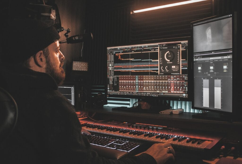 Man stares at a DAW in home recording studio