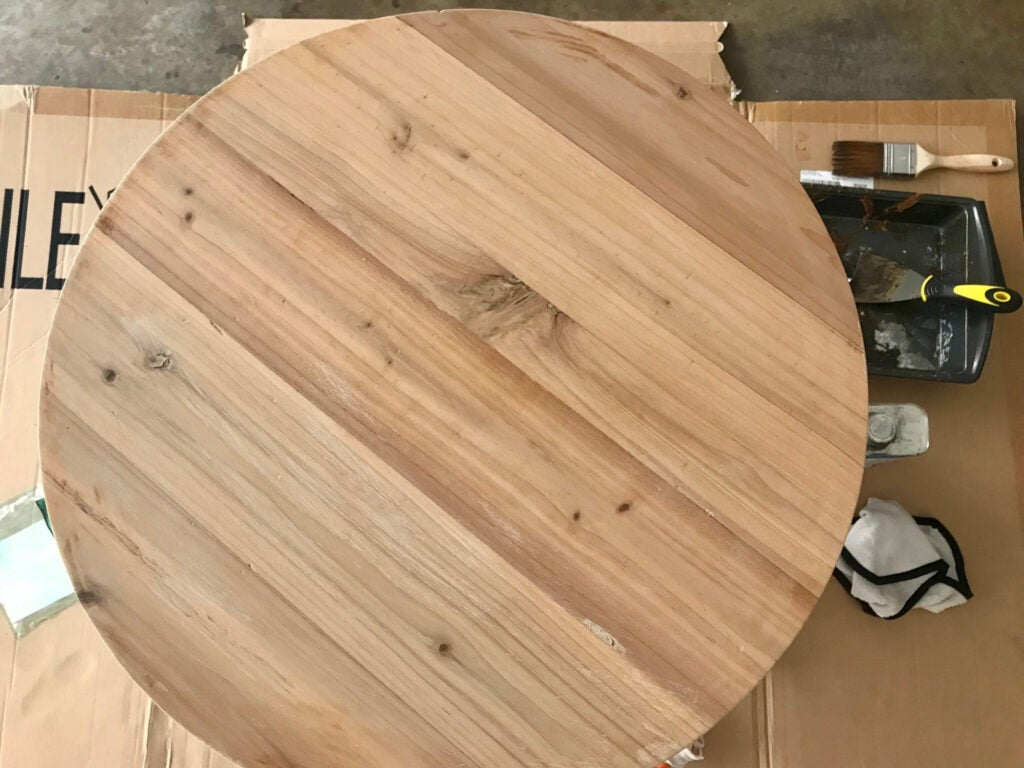 An unfinished table after its finish was removed and the wood sanded.