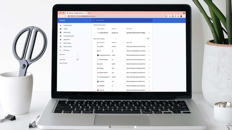 laptop on white desk with google chrome on display