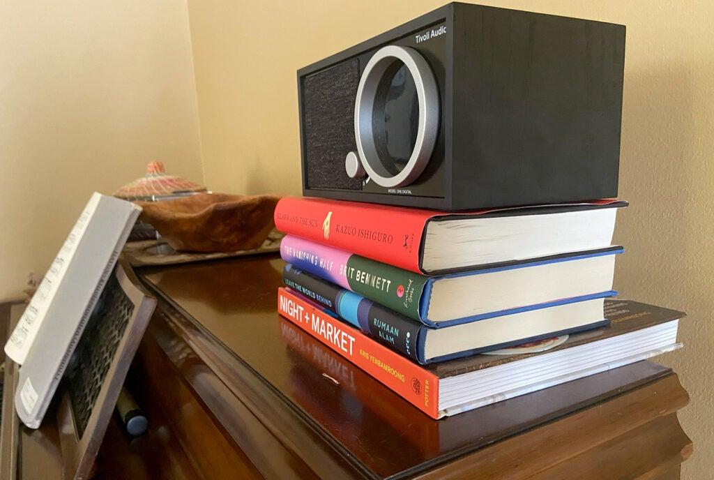 Tivoli Audio Model One (Gen. 2) on a stack of books
