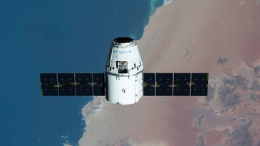 An aerial view of the SpaceX Dragon capsule over Earth.