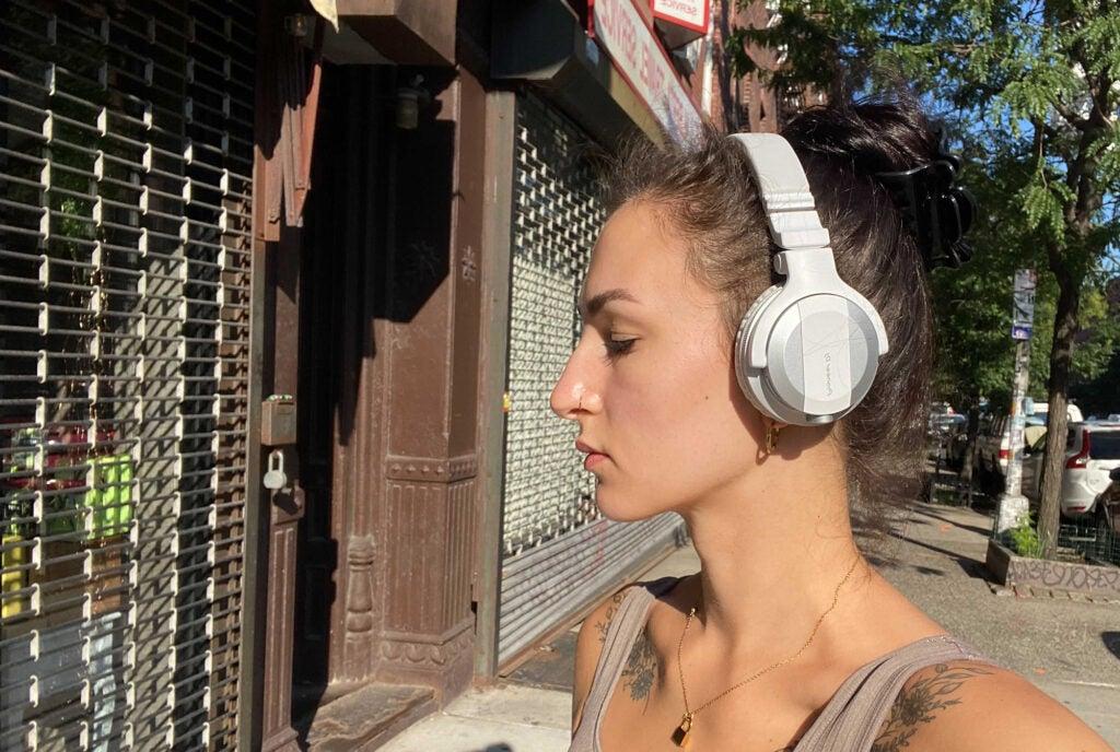 Pioneer DJ HDJ-CUE1BT headphones on woman's head