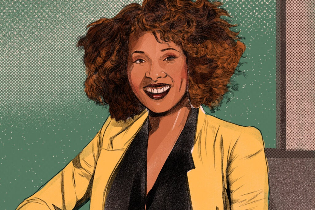 a black woman in a yellow blazer on a green background