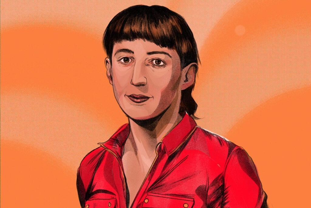 a woman with a brown ponytail on an orange background