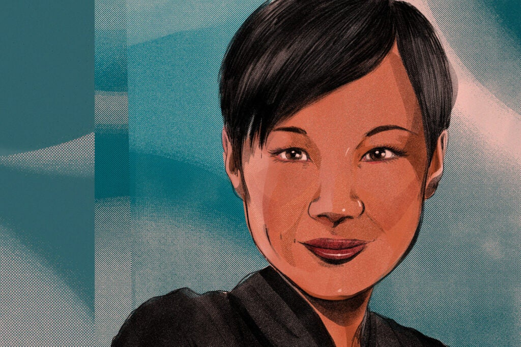 an asian woman with short hair on a blue background
