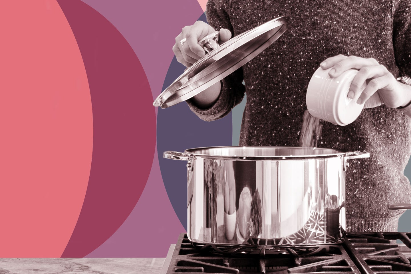 A person pouring a bunch of salt into a metal cooking pot on a gas stove.